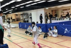 Children are learning fencing at Asian Fencing College