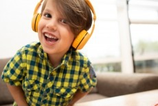 Buddyphones kid is happy with headphone