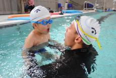 Hong Kong Swimming Academy Alex Fong is teaching a student