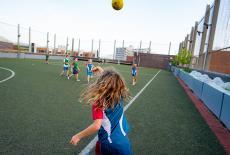 Hong Kong Academy students playing football